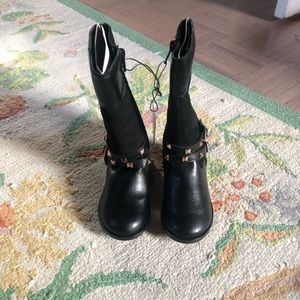 Toddler girl riding boots